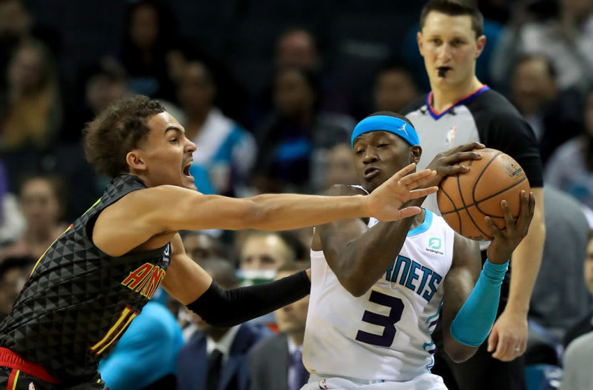 CHARLOTTE, NORTH CAROLINA - DECEMBER 08: Trae Young #11 of the Atlanta Hawks tries to stop Terry Rozier #3 of the Charlotte Hornets during their game at Spectrum Center on December 08, 2019 in Charlotte, North Carolina. NOTE TO USER: User expressly acknowledges and agrees that, by downloading and or using this photograph, User is consenting to the terms and conditions of the Getty Images License Agreement. (Photo by Streeter Lecka/Getty Images)
