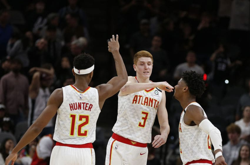 SAN ANTONIO, TX - JANUARY 17: Kevin Huerter #3 of the Atlanta Hawks celebrates his game winning three with De'Andre Hunter #12 and Cam Reddish #22 during second half action at AT&T Center on January 17, 2020 in San Antonio, Texas. Atlanta Hawks defeated the San Antonio Spurs 121-120. NOTE TO USER: User expressly acknowledges and agrees that ,by downloading and or using this photograph, User is consenting to the terms and conditions of the Getty Images License Agreement. (Photo by Ronald Cortes/Getty Images)
