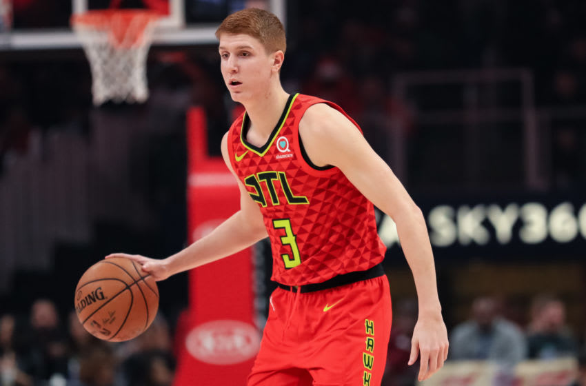 ATLANTA, GA - DECEMBER 27: Kevin Huerter #3 of the Atlanta Hawks controls the ball during a game against the Milwaukee Bucks at State Farm Arena on December 27, 2019 in Atlanta, Georgia. NOTE TO USER: User expressly acknowledges and agrees that, by downloading and or using this photograph, User is consenting to the terms and conditions of the Getty Images License Agreement. (Photo by Carmen Mandato/Getty Images)