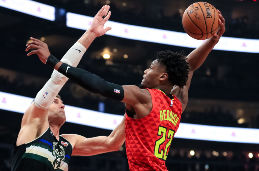 ATLANTA, GA - DECEMBER 27: Cam Reddish #22 of the Atlanta Hawks goes up for a basket in front of Brook Lopez #11 of the Milwaukee Bucks at State Farm Arena on December 27, 2019 in Atlanta, Georgia. NOTE TO USER: User expressly acknowledges and agrees that, by downloading and or using this photograph, User is consenting to the terms and conditions of the Getty Images License Agreement. (Photo by Carmen Mandato/Getty Images)