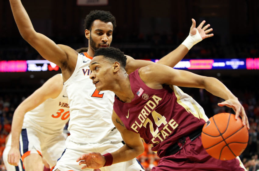 CHARLOTTESVILLE, VA - JANUARY 28: Devin Vassell #24 of the the Florida State Seminoles drives past Braxton Key #2 of the the Virginia Cavaliers in the first half during a game at John Paul Jones Arena on January 28, 2020 in Charlottesville, Virginia. (Photo by Ryan M. Kelly/Getty Images)