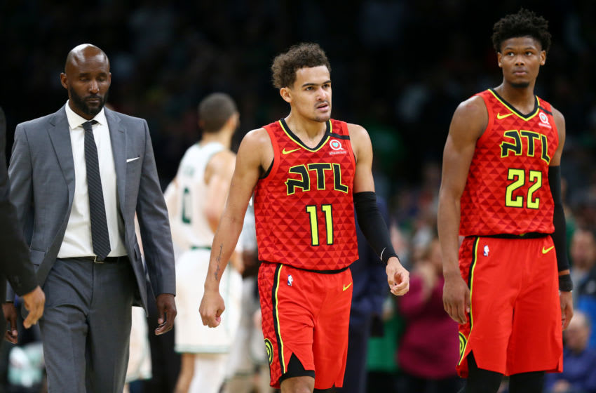 BOSTON, MASSACHUSETTS - JANUARY 03: Head Coach Lloyd Pierce of the Atlanta Hawks, Trae Young #11, and Cam Reddish #22 walk off the court after losing to the Boston Celtics 109-106 at TD Garden on January 03, 2020 in Boston, Massachusetts. (Photo by Maddie Meyer/Getty Images)