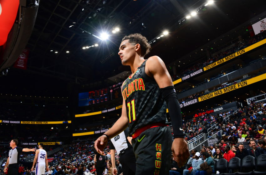 ATLANTA, GA - JANUARY 30: Trae Young #11 of the Atlanta Hawks looks on during the game against the Philadelphia 76ers on January 30, 2020 at State Farm Arena in Atlanta, Georgia. NOTE TO USER: User expressly acknowledges and agrees that, by downloading and/or using this Photograph, user is consenting to the terms and conditions of the Getty Images License Agreement. Mandatory Copyright Notice: Copyright 2020 NBAE (Photo by Scott Cunningham/NBAE via Getty Images)