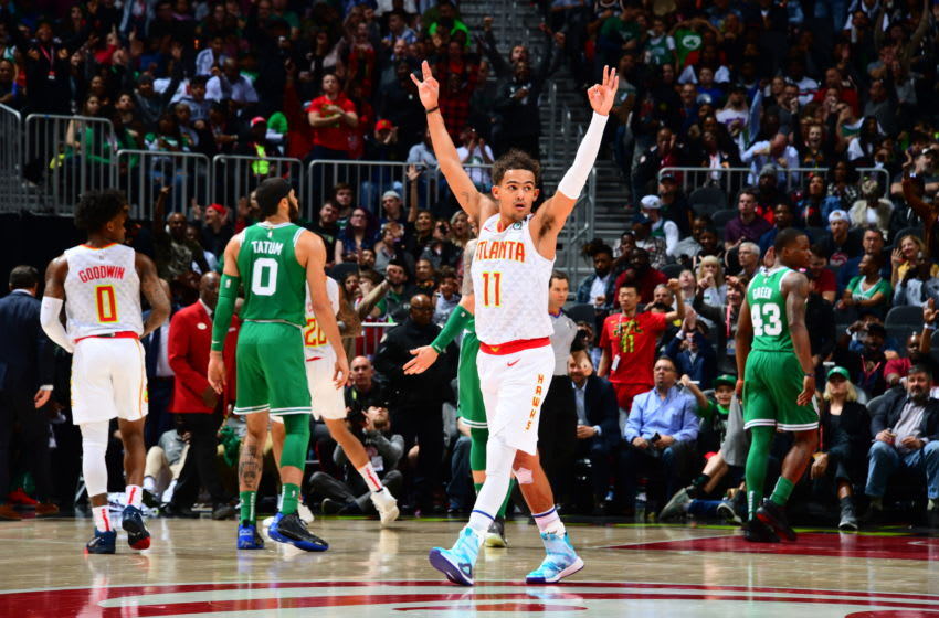 ATLANTA, GA - FEBRUARY 3: Trae Young #11 of the Atlanta Hawks celebrates during the game against the Boston Celtics on February 3, 2020 at State Farm Arena in Atlanta, Georgia. NOTE TO USER: User expressly acknowledges and agrees that, by downloading and/or using this Photograph, user is consenting to the terms and conditions of the Getty Images License Agreement. Mandatory Copyright Notice: Copyright 2020 NBAE (Photo by Scott Cunningham/NBAE via Getty Images)