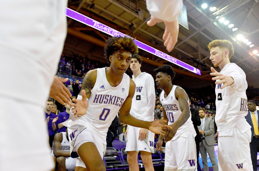 SEATTLE, WASHINGTON - JANUARY 30: Jaden McDaniels #0 of the Washington Huskies high-fives his teammates during player introductions before the game against the Arizona Wildcats at Hec Edmundson Pavilion on January 30, 2020 in Seattle, Washington. (Photo by Alika Jenner/Getty Images)