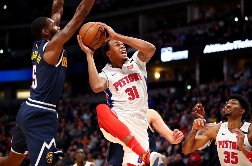 DENVER, CO - FEBRUARY 25: John Henson #31 of the Detroit Pistons grabs a rebound against Will Barton #5 of the Denver Nuggets at Pepsi Center on February 25, 2020 in Denver, Colorado. NOTE TO USER: User expressly acknowledges and agrees that, by downloading and/or using this photograph, user is consenting to the terms and conditions of the Getty Images License Agreement (Photo by Jamie Schwaberow/Getty Images)
