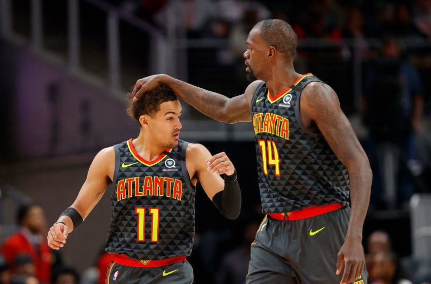 ATLANTA, GEORGIA - FEBRUARY 09: Dewayne Dedmon #14 of the Atlanta Hawks reacts with Trae Young #11 after dunking against the New York Knicks in the first half at State Farm Arena on February 09, 2020 in Atlanta, Georgia. NOTE TO USER: User expressly acknowledges and agrees that, by downloading and/or using this photograph, user is consenting to the terms and conditions of the Getty Images License Agreement. (Photo by Kevin C. Cox/Getty Images)