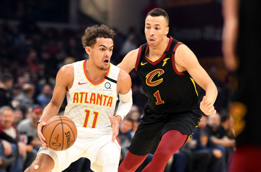 CLEVELAND, OHIO - FEBRUARY 12: Trae Young #11 of the Atlanta Hawks drives around Dante Exum #1 of the Cleveland Cavaliers during the first half at Rocket Mortgage Fieldhouse on February 12, 2020 in Cleveland, Ohio. NOTE TO USER: User expressly acknowledges and agrees that, by downloading and/or using this photograph, user is consenting to the terms and conditions of the Getty Images License Agreement. (Photo by Jason Miller/Getty Images)