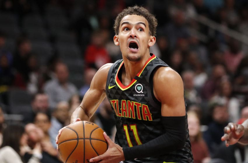 ATLANTA, GA - MARCH 09: Trae Young #11 of the Atlanta Hawks controls the ball in overtime of an NBA game against the Charlotte Hornets at State Farm Arena on March 9, 2020 in Atlanta, Georgia. NOTE TO USER: User expressly acknowledges and agrees that, by downloading and/or using this photograph, user is consenting to the terms and conditions of the Getty Images License Agreement. (Photo by Todd Kirkland/Getty Images)
