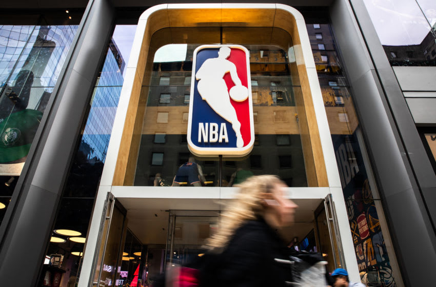 NEW YORK, NY - MARCH 12: A pedestrian walks past the NBA store on 5th Avenue on March 12, 2020 in New York City. The National Basketball Association said they would suspend all games after player Rudy Gobert of the Utah Jazz reportedly tested positive for the Coronavirus (COVID-19). (Photo by Jeenah Moon/Getty Images)