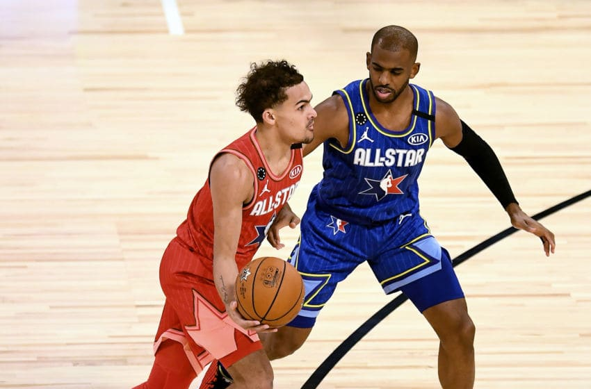 CHICAGO, ILLINOIS - FEBRUARY 16: Trae Young #24 of Team Giannis dribbles the ball while being guarded by Chris Paul #2 of Team LeBron in the fourth quarter during the 69th NBA All-Star Game at the United Center on February 16, 2020 in Chicago, Illinois. NOTE TO USER: User expressly acknowledges and agrees that, by downloading and or using this photograph, User is consenting to the terms and conditions of the Getty Images License Agreement. (Photo by Stacy Revere/Getty Images)