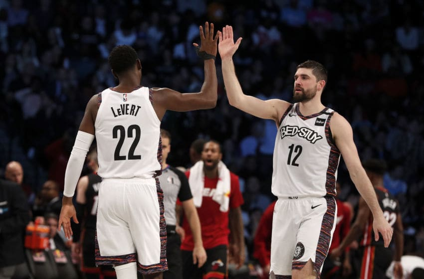 NEW YORK, NEW YORK - JANUARY 10: (NEW YORK DAILIES OUT) Caris LeVert #22 and Joe Harris #12 of the Brooklyn Nets in action against the Miami Heat at Barclays Center on January 10, 2020 in New York City. The Nets defeated the Heat 117-113. NOTE TO USER: User expressly acknowledges and agrees that, by downloading and or using this photograph, User is consenting to the terms and conditions of the Getty Images License Agreement. (Photo by Jim McIsaac/Getty Images)