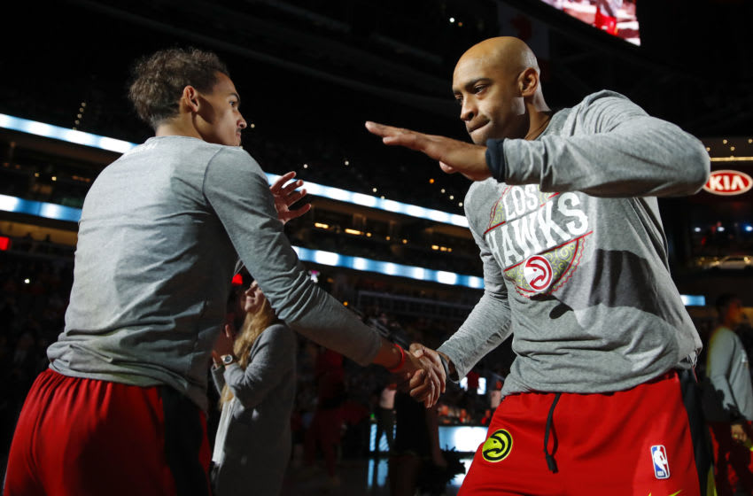 ATLANTA, GA - MARCH 09: Trae Young #11 reacts with Vince Carter #15 prior to an NBA game against the Charlotte Hornets at State Farm Arena on March 9, 2020 in Atlanta, Georgia. NOTE TO USER: User expressly acknowledges and agrees that, by downloading and/or using this photograph, user is consenting to the terms and conditions of the Getty Images License Agreement. (Photo by Todd Kirkland/Getty Images)