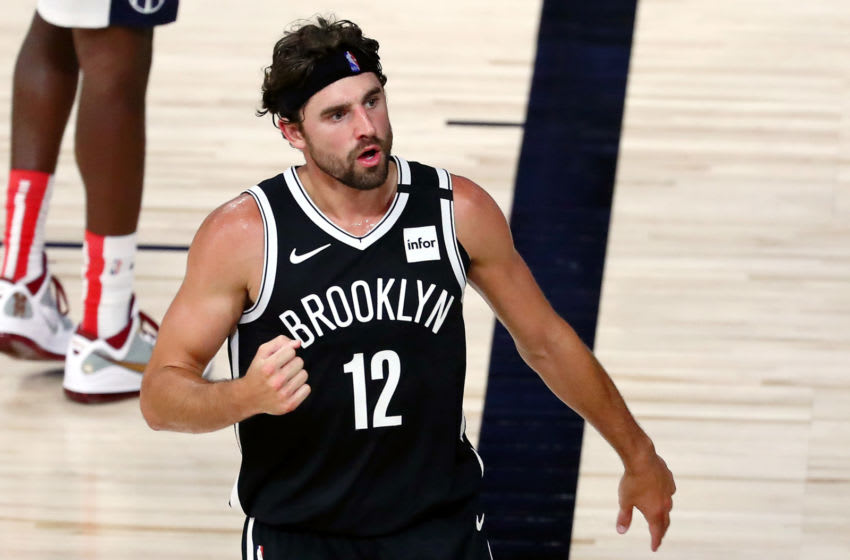 LAKE BUENA VISTA, FLORIDA - AUGUST 02: Brooklyn Nets forward Joe Harris #12 reacts after a play against the Washington Wizards in the second half of a NBA basketball game at HP Field House at ESPN Wide World Of Sports Complex on August 2, 2020 in Lake Buena Vista, Florida. NOTE TO USER: User expressly acknowledges and agrees that, by downloading and or using this photograph, User is consenting to the terms and conditions of the Getty Images License Agreement. (Photo by Kim Klement-Pool/Getty Images)
