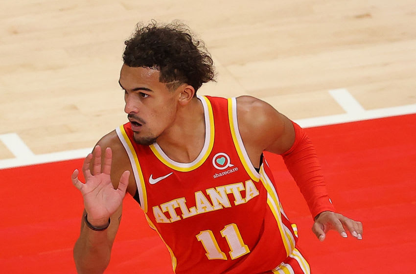 ATLANTA, GEORGIA - DECEMBER 28: Trae Young #11 of the Atlanta Hawks reacts after scoring a basket against the Detroit Pistons during the first half at State Farm Arena on December 28, 2020 in Atlanta, Georgia. NOTE TO USER: User expressly acknowledges and agrees that, by downloading and or using this photograph, User is consenting to the terms and conditions of the Getty Images License Agreement. (Photo by Kevin C. Cox/Getty Images)
