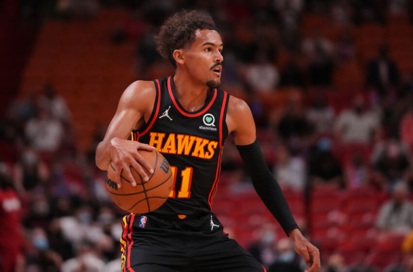 MIAMI, FLORIDA - OCTOBER 04: Trae Young #11 of the Atlanta Hawks dribbles the ball up the court against the Miami Heat during the preseason game at FTX Arena on October 04, 2021 in Miami, Florida. NOTE TO USER: User expressly acknowledges and agrees that, by downloading and/or using this Photograph, user is consenting to the terms and conditions of the Getty Images License Agreement. Mandatory Copyright Notice: Copyright 2021 NBAE (Photo by Mark Brown/Getty Images)