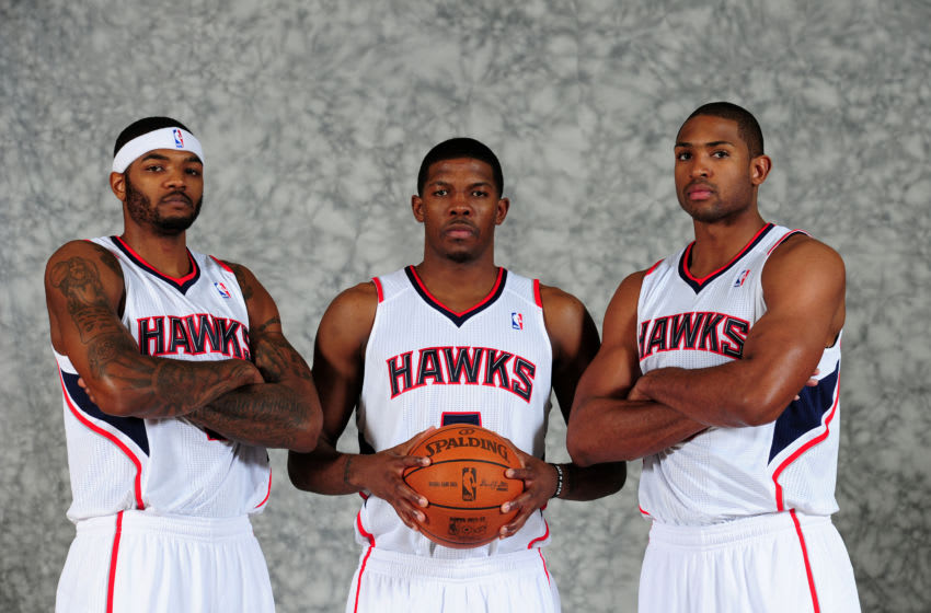 ATLANTA - DECEMBER 12: Josh Smith #5, Joe Johnson #2, and Al Horford #15 of the Atlanta Hawks poses during 2011 NBA Media Day on December 12, 2011 at Philips Arena in Atlanta, Georgia. NOTE TO USER: User expressly acknowledges and agrees that, by downloading and/or using this Photograph, user is consenting to the terms and conditions of the Getty Images License Agreement. Mandatory Copyright Notice: Copyright 2010 NBAE (Photo by Scott Cunningham/NBAE via Getty Images)