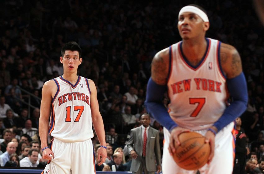 NEW YORK, NY - MARCH 20: (NEW YORK DAILIES OUT) Jeremy Lin #17 and Carmelo Anthony #7 of the New York Knicks in action against the Toronto Raptors on March 20, 2012 at Madison Square Garden in New York City. The Knicks defeated the Raptors 106-87. NOTE TO USER: User expressly acknowledges and agrees that, by downloading and/or using this Photograph, user is consenting to the terms and conditions of the Getty Images License Agreement. (Photo by Jim McIsaac/Getty Images)