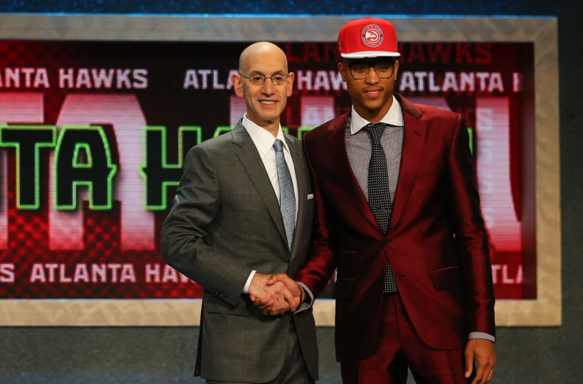 NEW YORK, NY - JUNE 25: Kelly Oubre Jr. poses with Commissioner Adam Silver after being selected 15th overall by the Atlanta Hawks in the First Round of the 2015 NBA Draft at the Barclays Center on June 25, 2015 in the Brooklyn borough of New York City. NOTE TO USER: User expressly acknowledges and agrees that, by downloading and or using this photograph, User is consenting to the terms and conditions of the Getty Images License Agreement. (Photo by Elsa/Getty Images)