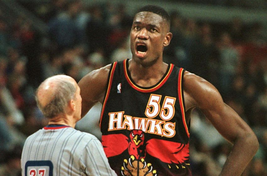AUBURN HILLS, UNITED STATES: The Atlanta Hawks' Dikembe Mutombo (R) complains to referee Dick Bavetta (L) after a foul call went against Atlanta with less than a minute left in the game 22 November at the Palace in Auburn Hills, MI. The Pistons beat the Hawks 87-85. AFP PHOTO/Matt CAMPBELL (Photo credit should read MATT CAMPBELL/AFP via Getty Images)