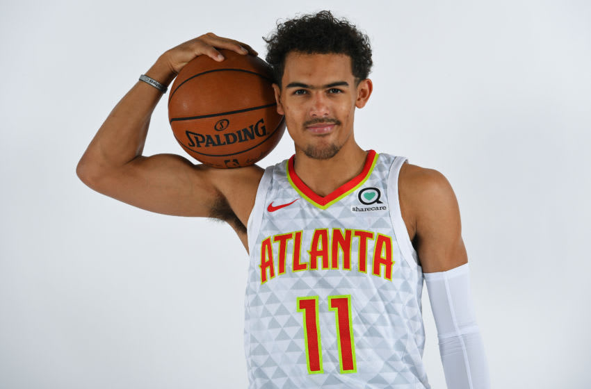 ATLANTA, GA - JUNE 25: Trae Young #11 of the Atlanta Hawks poses for a portrait after an introductory press conference on June 25, 2018 at Emory Healthcare Courts in Atlanta, Georgia. NOTE TO USER: User expressly acknowledges and agrees that, by downloading and/or using this Photograph, user is consenting to the terms and conditions of the Getty Images License Agreement. Mandatory Copyright Notice: Copyright 2018 NBAE (Photo by Scott Cunningham/NBAE via Getty Images)