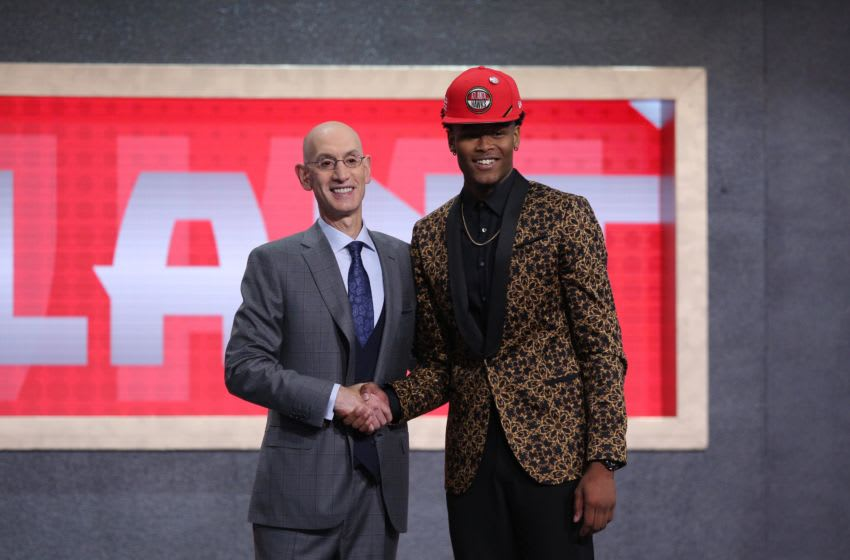 Jun 20, 2019; Brooklyn, NY, USA; Cam Reddish (Duke) greets NBA commissioner Adam Silver after being selected as the number ten overall pick to the Atlanta Hawks in the first round of the 2019 NBA Draft at Barclays Center. Mandatory Credit: Brad Penner-USA TODAY Sports