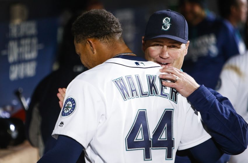 Apr 25, 2016; Seattle, WA, USA; Seattle Mariners manager Scott Servais (9) talks with starting pitcher Taijuan Walker (44) following the seventh inning against the Houston Astros at Safeco Field. Mandatory Credit: Joe Nicholson-USA TODAY Sports