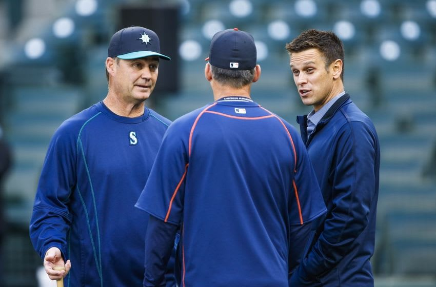 Apr 25, 2016; Seattle, WA, USA; Seattle Mariners manager Scott Servais (9, left) and general manager Jerry Dipoto talk with a member of the Houston Astros during batting practice at Safeco Field. Mandatory Credit: Joe Nicholson-USA TODAY Sports