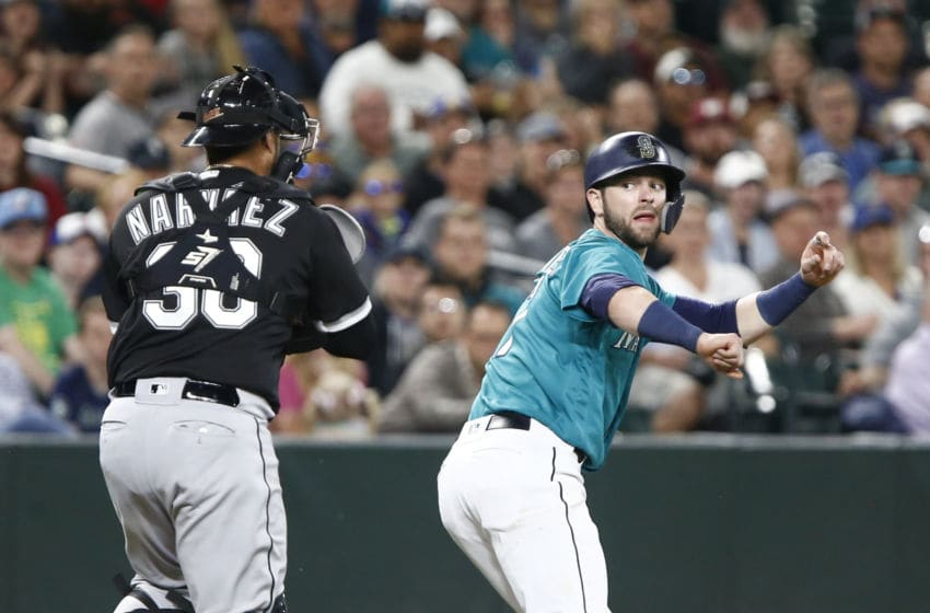 SEATTLE, WA - JULY 20: Mitch Haniger #17 of the Seattle Mariners tries to outrun Omar Narvaez #38 of the Chicago White Sox but is tagged out in the eighth inning at Safeco Field on July 20, 2018 in Seattle, Washington. (Photo by Lindsey Wasson/Getty Images)