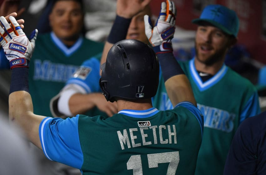 PHOENIX, AZ - AUGUST 24: Mitch Haniger #17 of the Seattle Mariners celebrates with teammates in the dugout after hitting a solo home run against the Arizona Diamondbacks during the fifth inning at Chase Field on August 24, 2018 in Phoenix, Arizona. The players are wearing special jerseys as part of MLB Players Weekend. (Photo by Norm Hall/Getty Images)
