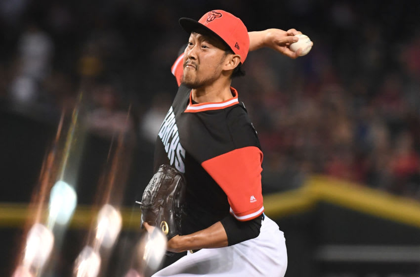 PHOENIX, AZ - AUGUST 26: Yoshihisa Hirano #66 of the Arizona Diamondbacks delivers a pitch in the ninth inning of the MLB game against the Seattle Mariners at Chase Field on August 26, 2018 in Phoenix, Arizona. All players across MLB wear nicknames on their backs as well as colorful, non-traditional uniforms featuring alternate designs inspired by youth-league uniforms during Players Weekend. (Photo by Jennifer Stewart/Getty Images)