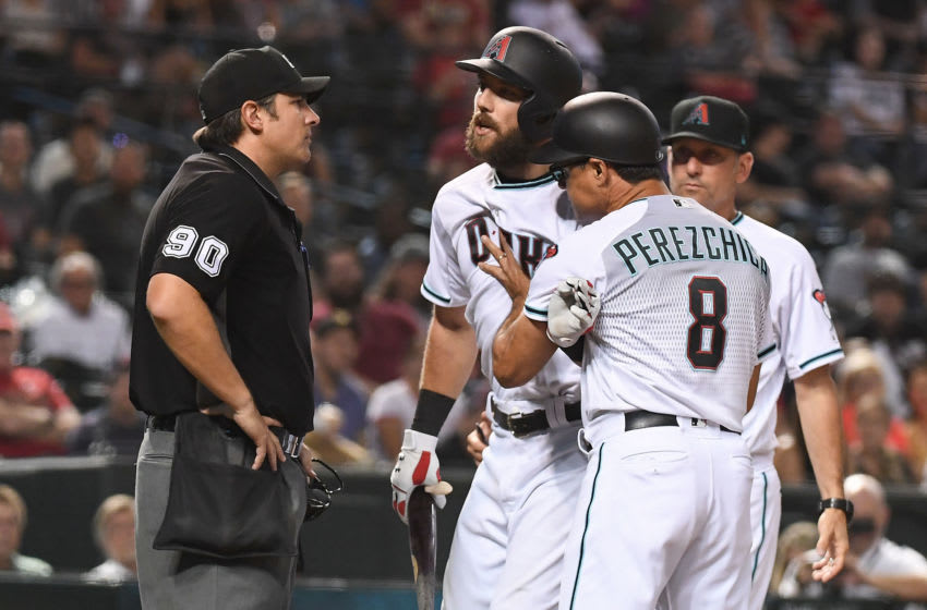 PHOENIX, AZ - SEPTEMBER 06: Steven Souza Jr. #28 of the Arizona Diamondbacks is held back by third base coach Tony Perezchica #8 while arguing a called strike three by umpire Mark Ripperger #90 in the eighth inning of the MLB game against the Atlanta Braves at Chase Field on September 6, 2018 in Phoenix, Arizona. (Photo by Jennifer Stewart/Getty Images)