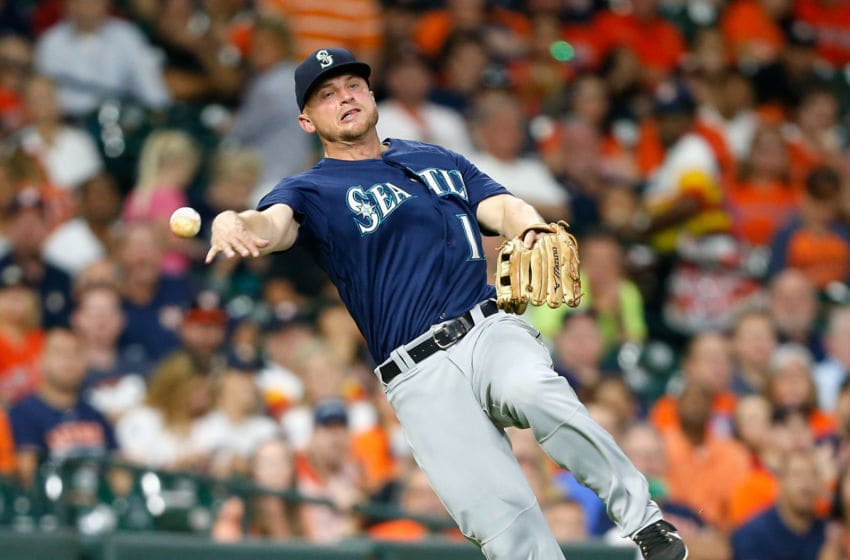 HOUSTON, TX - SEPTEMBER 19: Kyle Seager #15 of the Seattle Mariners throws to first base but unable to retire George Springer #4 of the Houston Astros in the fourth inning at Minute Maid Park on September 19, 2018 in Houston, Texas. (Photo by Bob Levey/Getty Images)