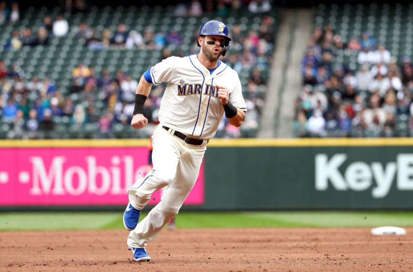 SEATTLE, WA - APRIL 14: Mitch Haniger #17 of the Seattle Mariners scores on a double off the bat of Domingo Santana in the third inning against the Houston Astros at T-Mobile Park on April 14, 2019 in Seattle, Washington. (Photo by Abbie Parr/Getty Images)