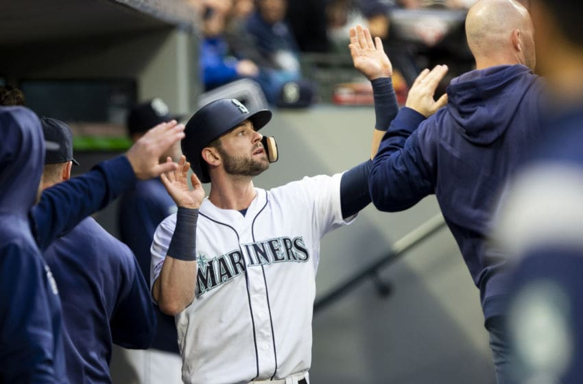 SEATTLE, WA - APRIL 25: Mitch Haniger #17 of the Seattle Mariners is greeted in the dugout after scoring on a single by Tim Beckham #1 in the first inning against the Texas Rangers at T-Mobile Park on April 25, 2019 in Seattle, Washington. (Photo by Lindsey Wasson/Getty Images)