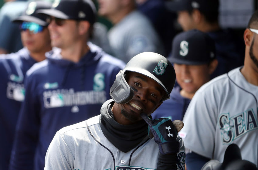 KANSAS CITY, MISSOURI - APRIL 11: Dee Gordon #9 of the Seattle Mariners reacts in the dugout after hitting a home run during the game against the Kansas City Royals at Kauffman Stadium on April 11, 2019 in Kansas City, Missouri. (Photo by Jamie Squire/Getty Images)