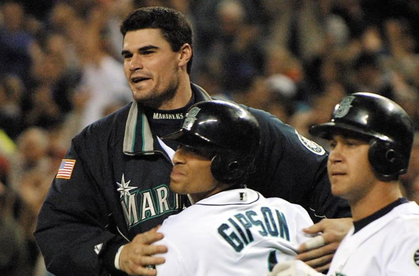 Seattle Mariner Charles Gipson (C) is congratulated by teammate Ben Davis (L) after scoring the winning run on a sacrifice fly by Ruben Sierra in the tenth inning of play against the Texas Ranger 18 September of 2002 in Seattle. The Mariners won, 3-2 . At right is Bret Boone. AFP PHOTO/Dan Levine (Photo by DAN LEVINE / AFP) (Photo credit should read DAN LEVINE/AFP via Getty Images)