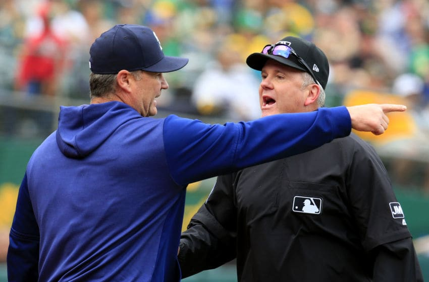 OAKLAND, CALIFORNIA - MAY 26: Manager Scott Servais #29 of the Seattle Mariners argues a call after being ejected by Umpire Mike Everitt #57 during the seventh inning against the Oakland Athletics at Oakland-Alameda County Coliseum on May 26, 2019 in Oakland, California. (Photo by Daniel Shirey/Getty Images)