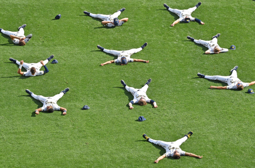 OMAHA, NE - JUNE 25: Players of the Michigan Wolverines stretch on the field, prior to game two of the College World Series Championship Series against the Vanderbilt Commodores on June 25, 2019 at TD Ameritrade Park Omaha in Omaha, Nebraska. (Photo by Peter Aiken/Getty Images)