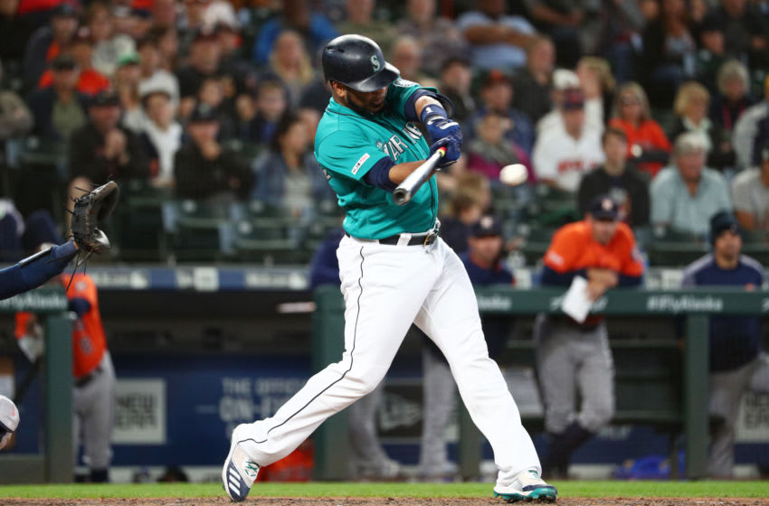 SEATTLE, WASHINGTON - JUNE 06: Edwin Encarnacion #10 of the Seattle Mariners hits an RBI single to score Dylan Moore #25 of the Seattle Mariners to tie the game 6-6 in the ninth inning against the Houston Astros during their game at T-Mobile Park on June 06, 2019 in Seattle, Washington. (Photo by Abbie Parr/Getty Images)