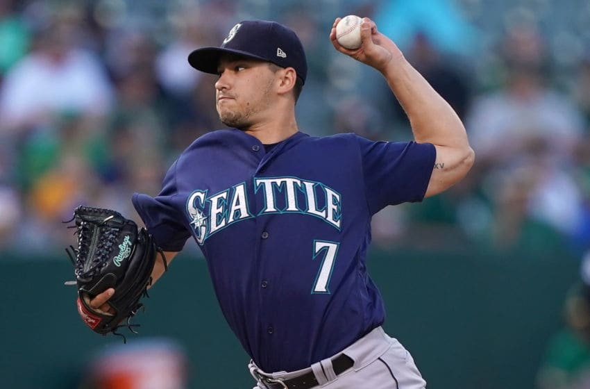OAKLAND, CA - JULY 16: Marco Gonzales #7 of the Seattle Mariners pitches against the Oakland Athletics in the bottom of the first inning of a Major League baseball game at Ring Central Coliseum on July 16, 2019 in Oakland, California. (Photo by Thearon W. Henderson/Getty Images)