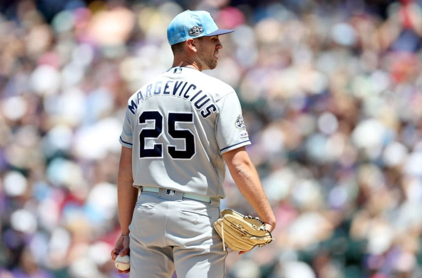 DENVER, COLORADO - JUNE 16: Starting pitcher Nick Margevicius #25 throws in the first inning against the Colorado Rockies at Coors Field on June 16, 2019 in Denver, Colorado. (Photo by Matthew Stockman/Getty Images)
