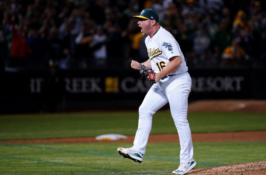 OAKLAND, CALIFORNIA - SEPTEMBER 17: Liam Hendriks, a free-agent, celebrates an A's win. Hendriks is a potential Seattle Mariners target. (Photo by Daniel Shirey/Getty Images)