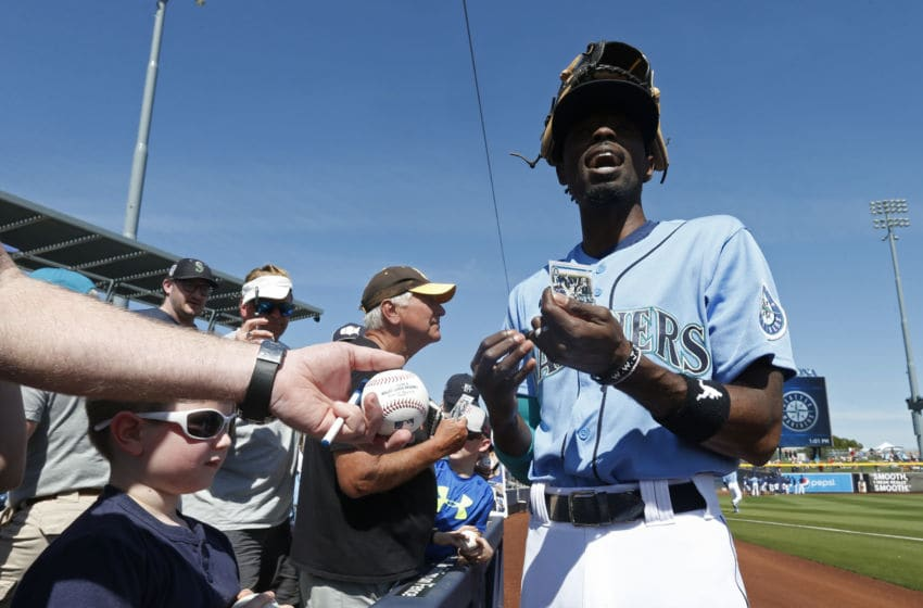 PEORIA, ARIZONA - MARCH 05: Dee Gordon #9 of the Seattle Mariners signs autographs for fans prior to a Cactus League spring training baseball game against the San Diego Padres at Peoria Stadium on March 05, 2020 in Peoria, Arizona. (Photo by Ralph Freso/Getty Images)