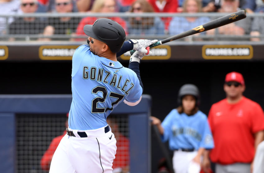 PEORIA, ARIZONA - MARCH 10: Carlos Gonzalez #27 of the Seattle Mariners follows though on a swing against the Los Angeles Angels during a spring training game at Peoria Stadium on March 10, 2020 in Peoria, Arizona. (Photo by Norm Hall/Getty Images)