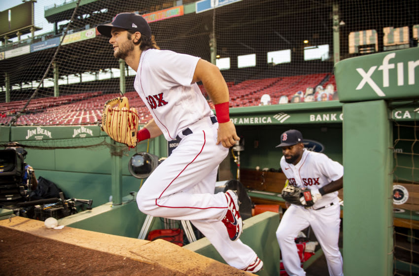 BOSTON, MA - AUGUST 11: Andrew Benintendi of the Boston Red Sox runs onto the field. Seattle Mariners trade ideas. (Photo by Billie Weiss/Boston Red Sox/Getty Images)