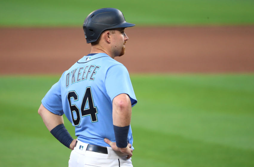 SEATTLE, WASHINGTON - JULY 19: Brian O'Keefe #64 of the Seattle Mariners looks on from third base in the seventh inning during a summer workout intrasquad game at T-Mobile Park on July 19, 2020 in Seattle, Washington. (Photo by Abbie Parr/Getty Images)
