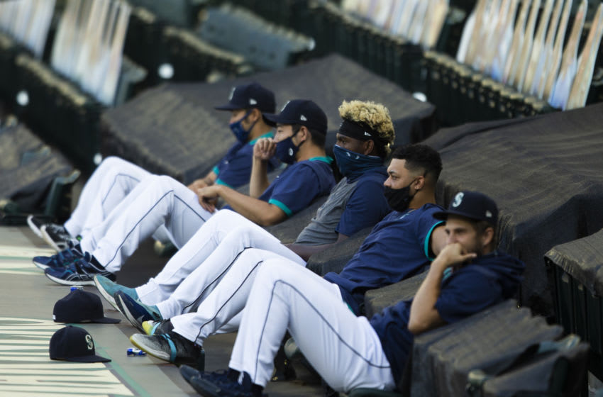 SEATTLE, WA - AUGUST 05: The Seattle Mariners pitchers, including Yusei Kikuchi and Justin Dunn sit above the dugout during the game. (Photo by Lindsey Wasson/Getty Images)