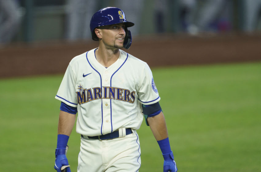 SEATTLE, WA - AUGUST 23: Braden Bishop #5 of the Seattle Mariners walks off the field after an at-bat during a game against the Texas Rangersat T-Mobile Park on August 23, 2020 in Seattle, Washington. The Mariners won 4-1. (Photo by Stephen Brashear/Getty Images)