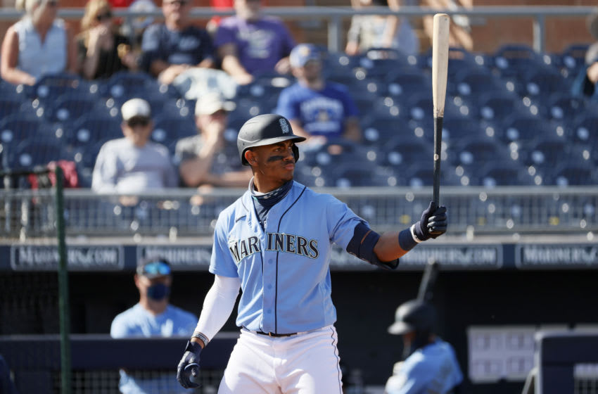 PEORIA, ARIZONA - MARCH 04: Julio Rodriguez of the Mariners at bat against the Rockies during an MLB spring training game. (Photo by Steph Chambers/Getty Images)